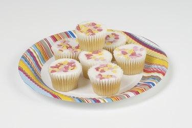 Fairy cakes on paper plate, studio shot