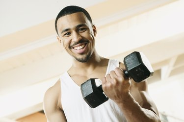 Man lifting hand weight