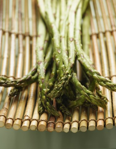Close up of asparagus on bamboo