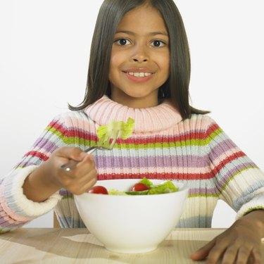 Hispanic girl eating salad