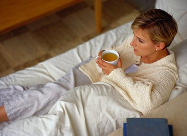 Young Woman Relaxing with a Cup of Tea