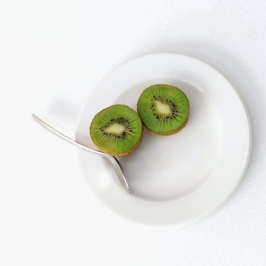 sliced kiwi on a plate with a fork
