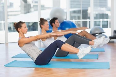 Side view of class doing ab exercises in Mat Pilates studio
