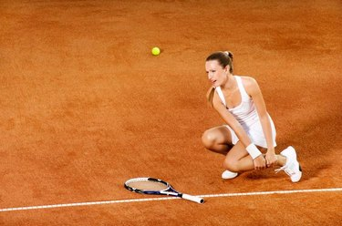 Ingured tennis female player crying from pain