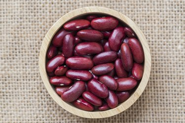 Dried red beans on a wooden table