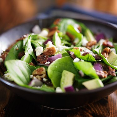 bowl of fresh avocado spinach salad