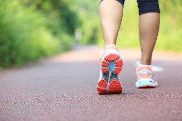 young fitness woman runner /hiker legs at forest trail