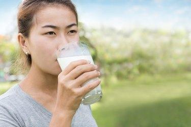 women drinking milk healthy lifestyle outdoor