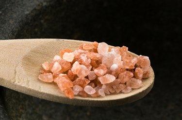 Spoonful of pink Himalayan rock