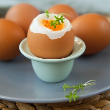 Easter boiled eggs with fresh grass