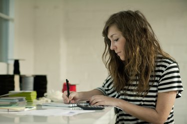 Young woman working at desk
