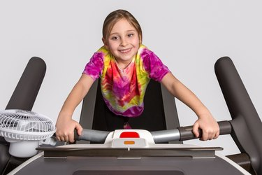 Young Girl Exercising on Treadmill