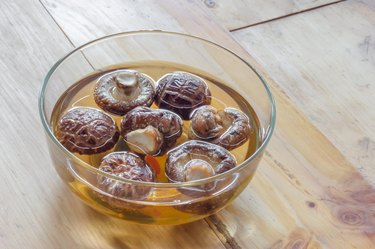 Dried shiitake mushroom in transparent bowl with water