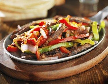 mexican beef fajitas in iron skillet