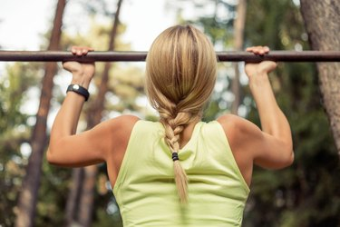 Fit and strong  woman doing pullups