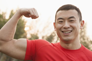 Muscular Man Flexing Bicep