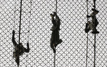 U.S. Army recruits completing an obstacle at Victory Tower during basic combat training.