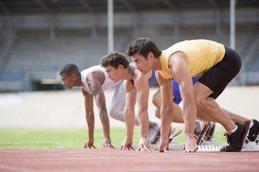 Athletes crouching at starting line