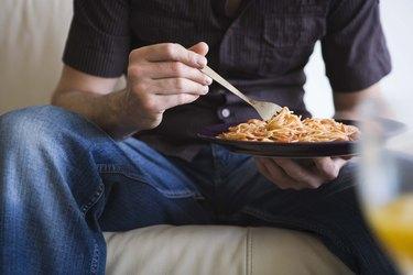 Man eating pasta