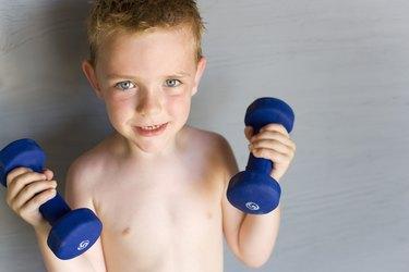 Boy lifting dumbbells