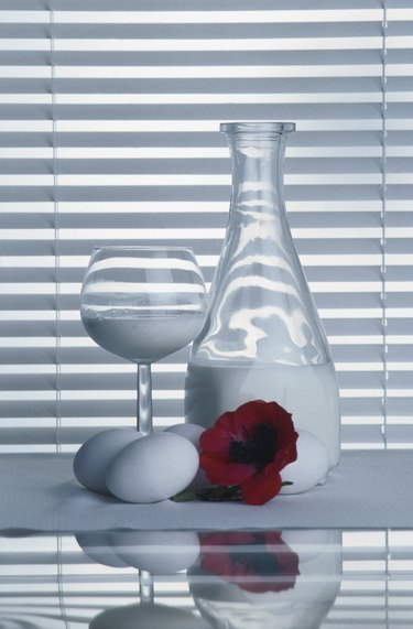 Elegant still life of milk and eggs