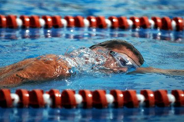 """""""An Airman swims in the 1,600-meter relay during the 379th Air Expeditionary Wing Sports Day on Sunday, April 23, 2006."""""""