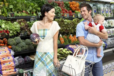 """""""Parents with daughter (9-12 months) in supermarket, smiling"""""""