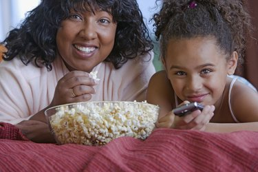 African mother and daughter eating popcorn