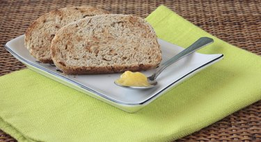 Sliced wholemeal bread with seeds and ghee (clarified butter)