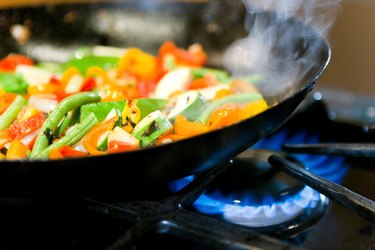 Vegetables cooking in skillet