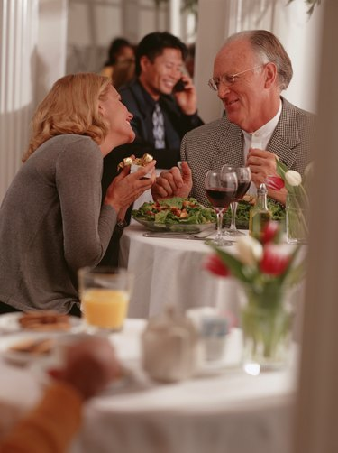 Mature couple sitting in restaurant, talking
