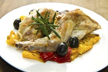 Baked rabbit with olives and pepper