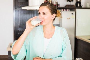 Women drinking milk in the kitchen