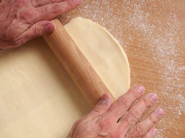 Rolling dough. Making Puff Pastry Series.