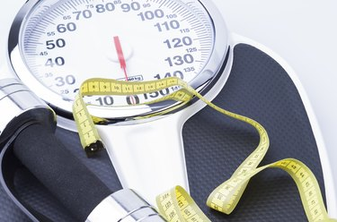 Scale, Measuring Tape, and Dumbbells