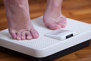 Womans feet and time for weight truth from a scale