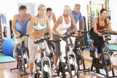 Group Of People In Spinning Class At Gym