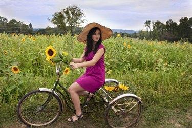 Woman on bike with sunflowers