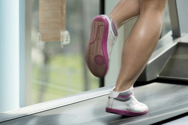 Woman Feet On Treadmill