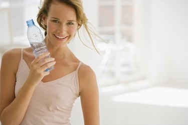 Woman holding bottled water