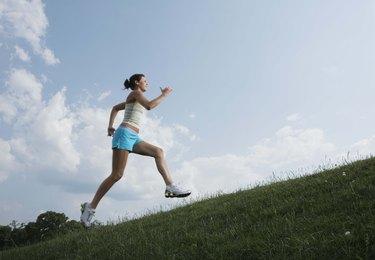 Woman running on hillside
