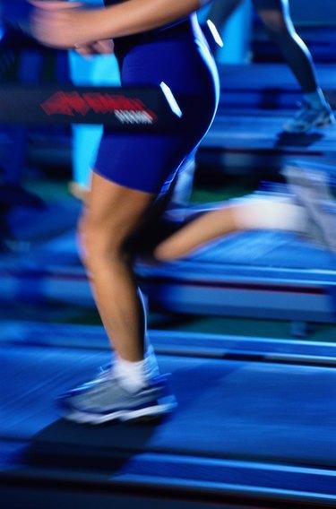 Woman's Legs Running on a Treadmill