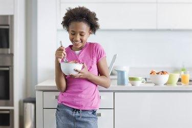 Girl Eating Cereal for Breakfast