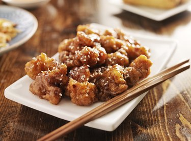 chinese sesame chicken with chopsticks