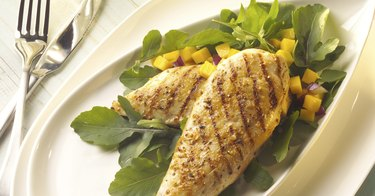 Close-up of grilled chicken breasts on a plate