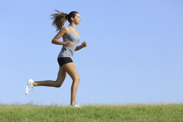 Beautiful woman runningwith the sky in background