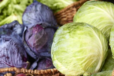 Purple And Ordinary Cabbages On Sale At the Market