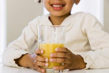 Girl with glass of orange juice