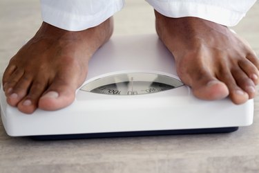 Close-up of a man standing on a scale