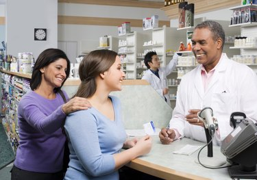 Pharmacist talking to customers